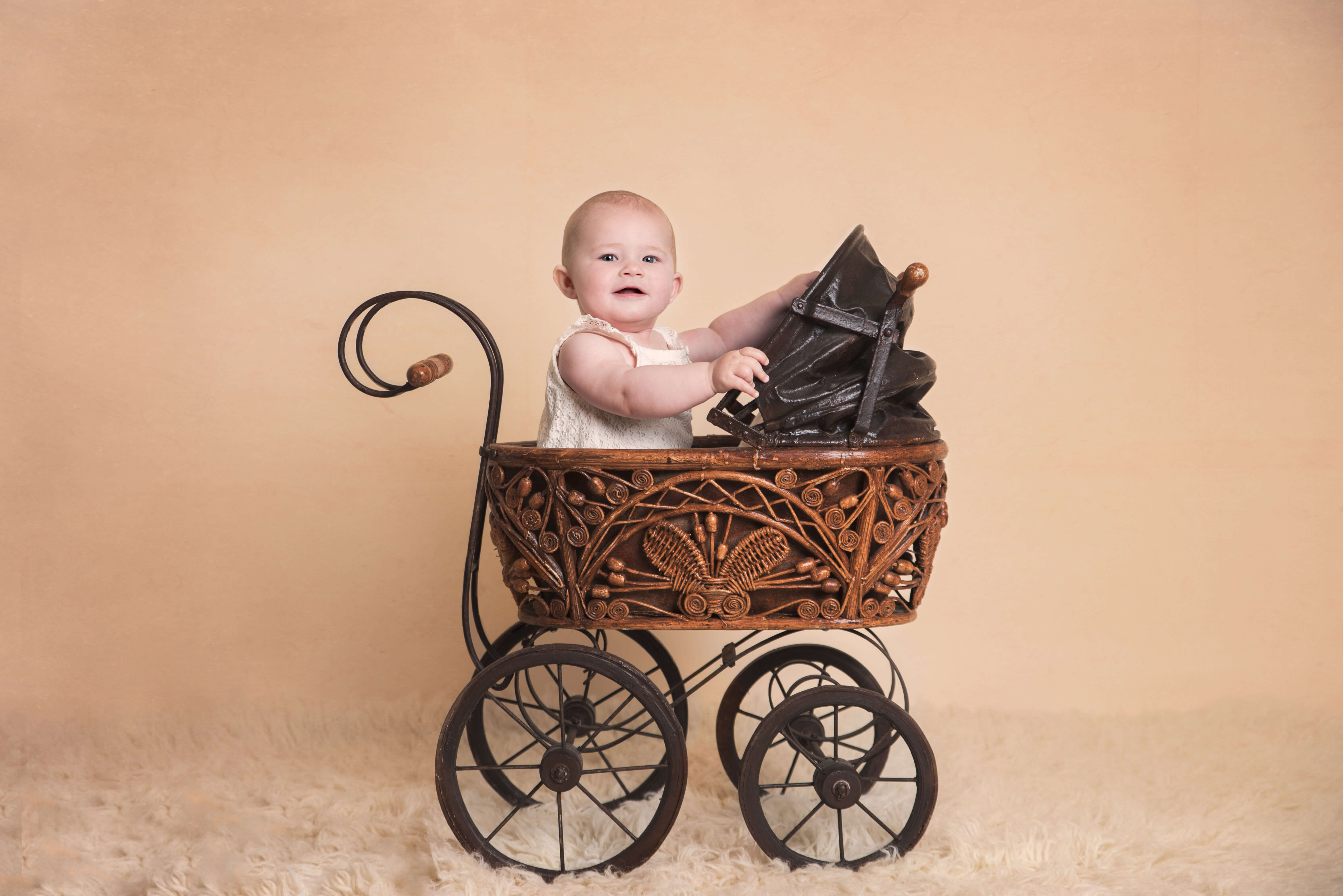 Slice of Life Little Sitters Session Gallery - Baby sat in a wicker pram, facing right