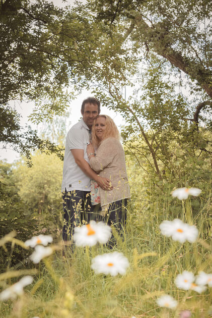 Slice of Life Photography - Engaged couple framed by Daisies, Boston wedding photographer