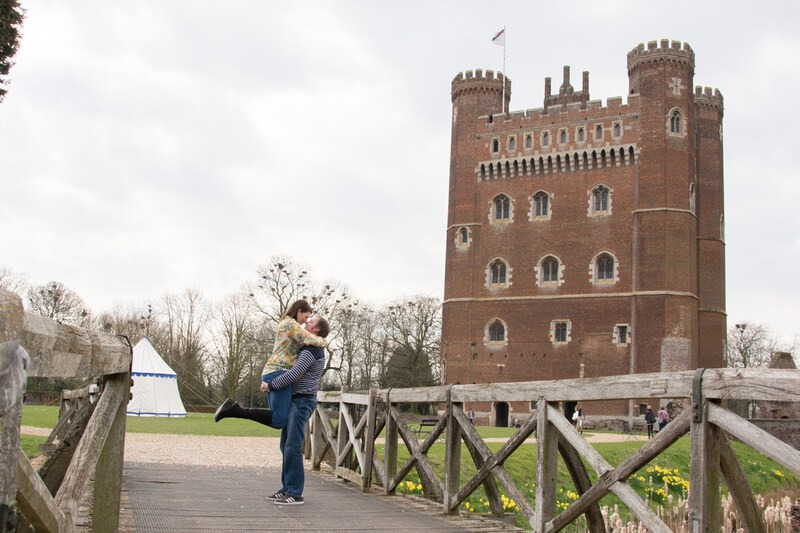 Slice of Life Photography - Pre wedding photo, couple on bridge with Tattersall Castle as the backdrop by Peterborough wedding photographer