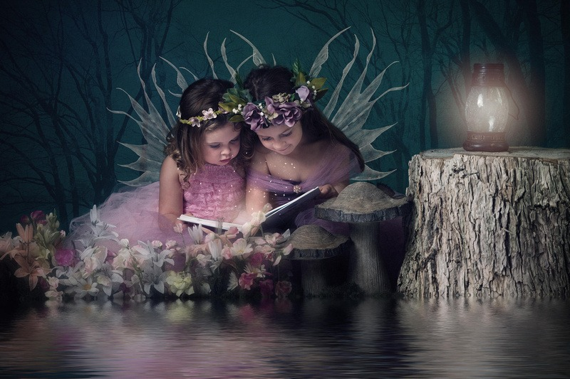 Slice of Life Photography - Two Little Girls Dressed as Fairies, reading a book Image