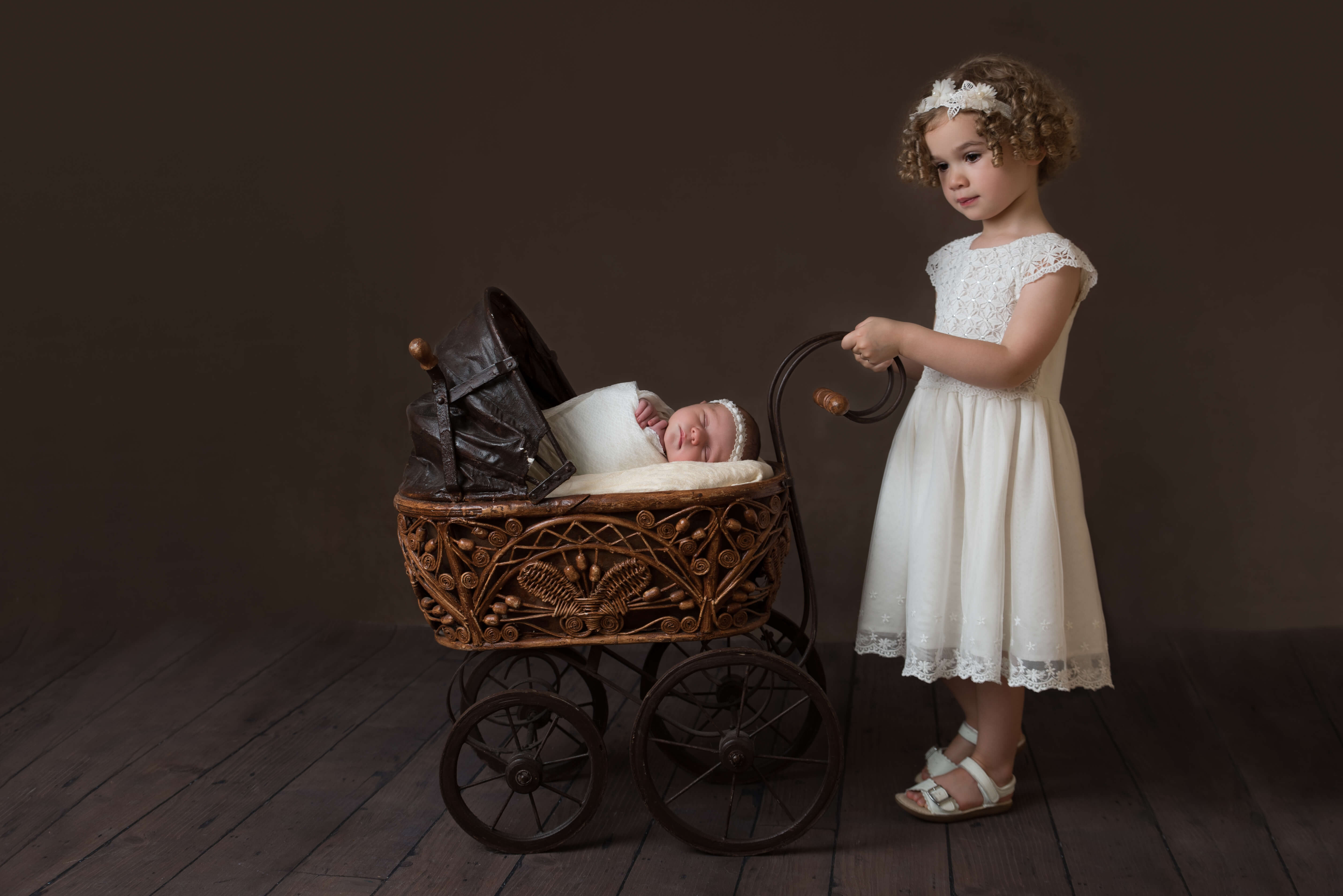 Slice of Life Photography - big sister, pushing newborn girl in victorian pram by Slice of Life Photography, Stamford Photographer