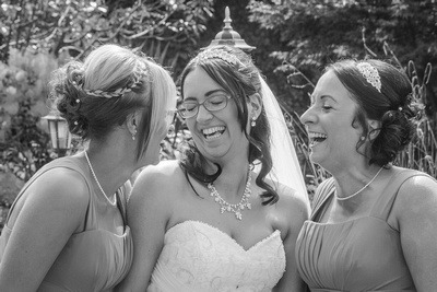 Slice of Life Photography - Bride and Bridesmaids sharing a laugh together