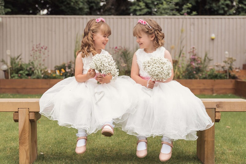 Beautiful flower girls having a giggle by Slice of Life Photography, Spalding wedding photographer