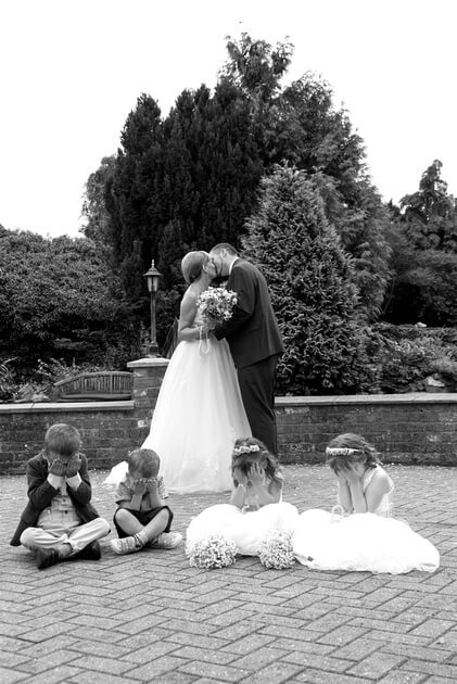 Slice of Life Photography - little ones hiding from 'the kiss', Spalding wedding photographer