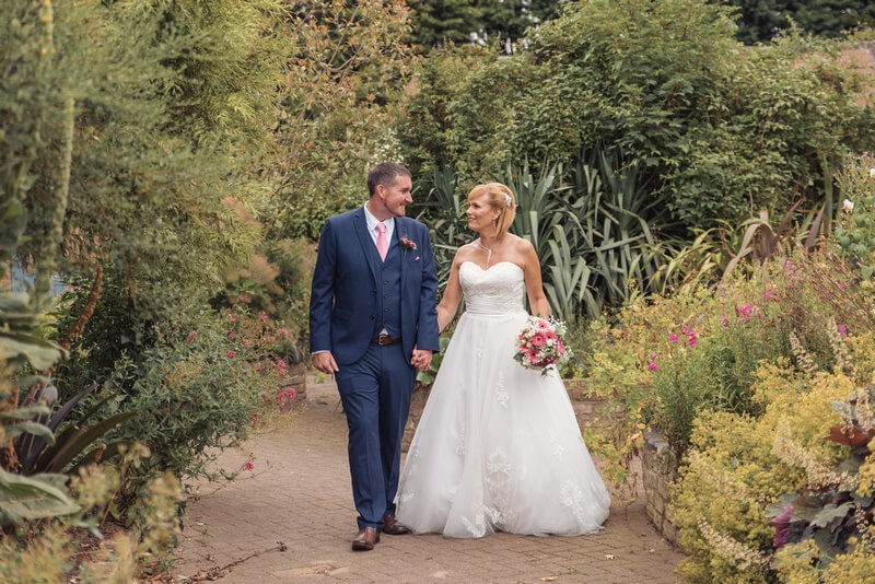 Slice of Life Photography - bride and groom walking in the grounds of Whaplode manor by slice of life photography, Lincoln wedding photographer
