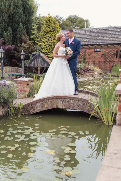 Bride and groom on the bride at Whaplode manor by Slice of Life Photography