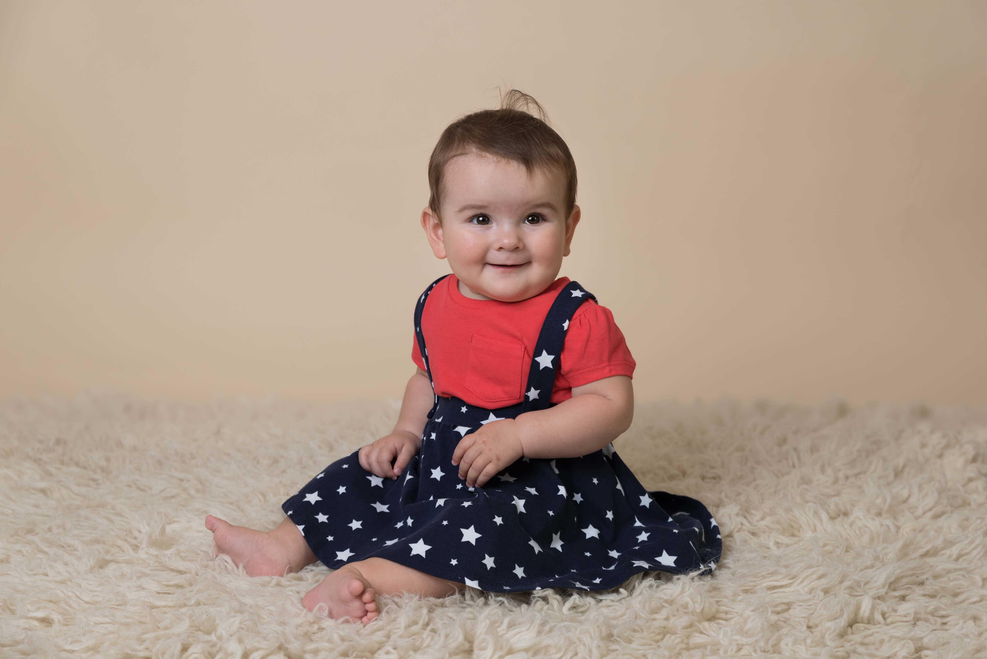 Slice of Life Little Sitters Session Gallery - Baby girl wearing a star pattern dress
