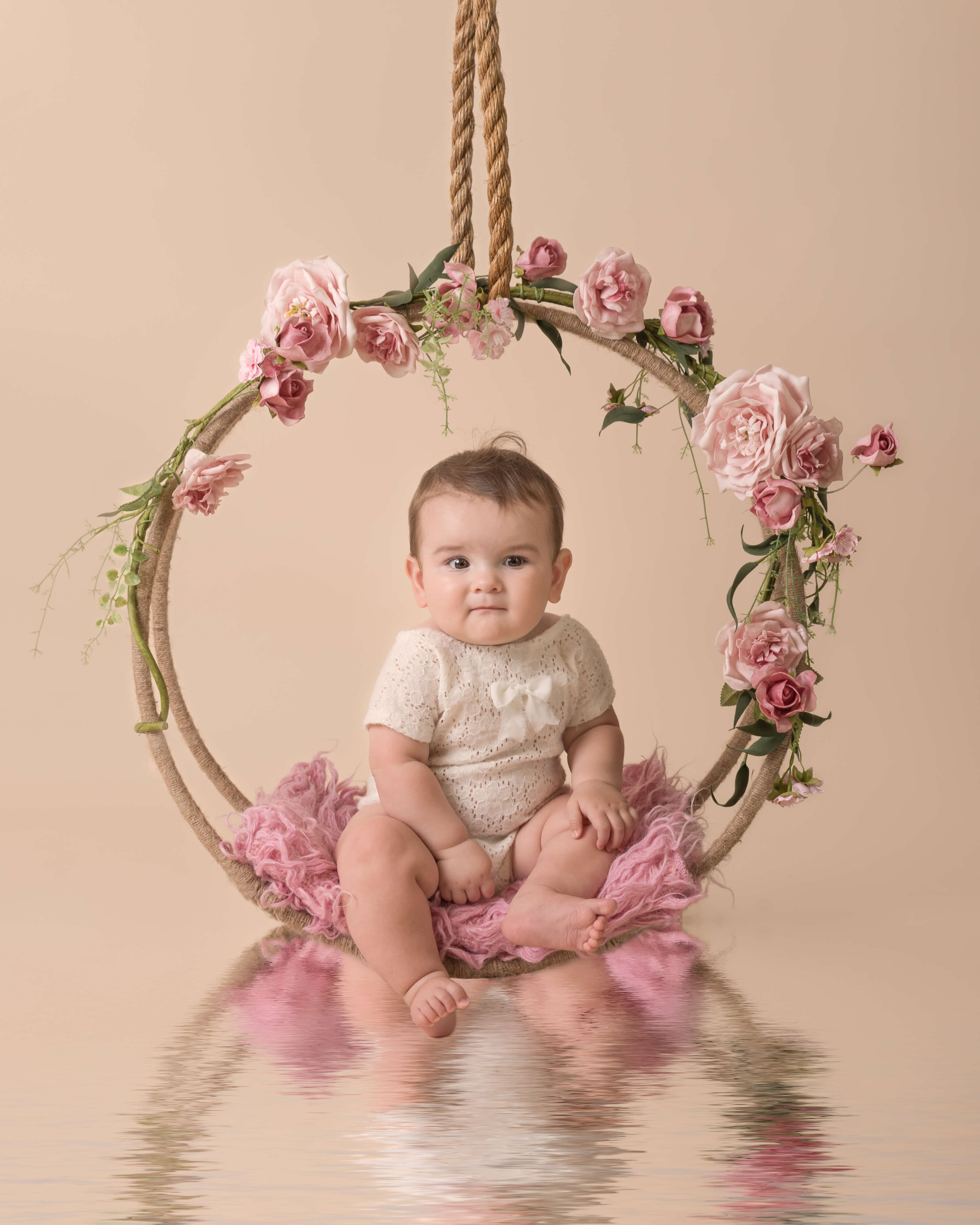 Slice of Life Little Sitters Session Gallery - Baby girl sat in a pink floral arrangement