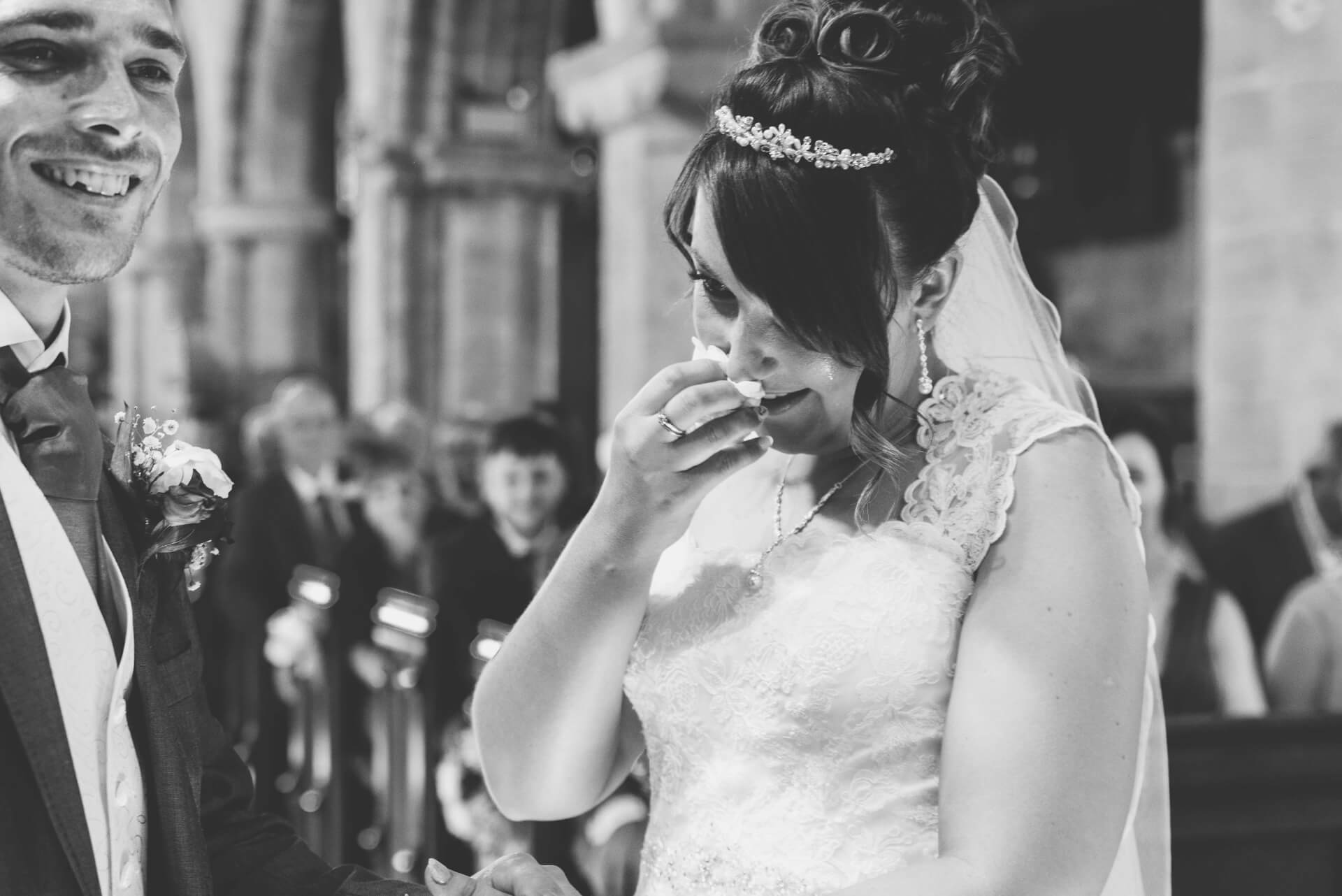 Bride crying at Whaplode Church ceremony - black and white photographs by Lincolnshire wedding photographer, Slice of Life Photography
