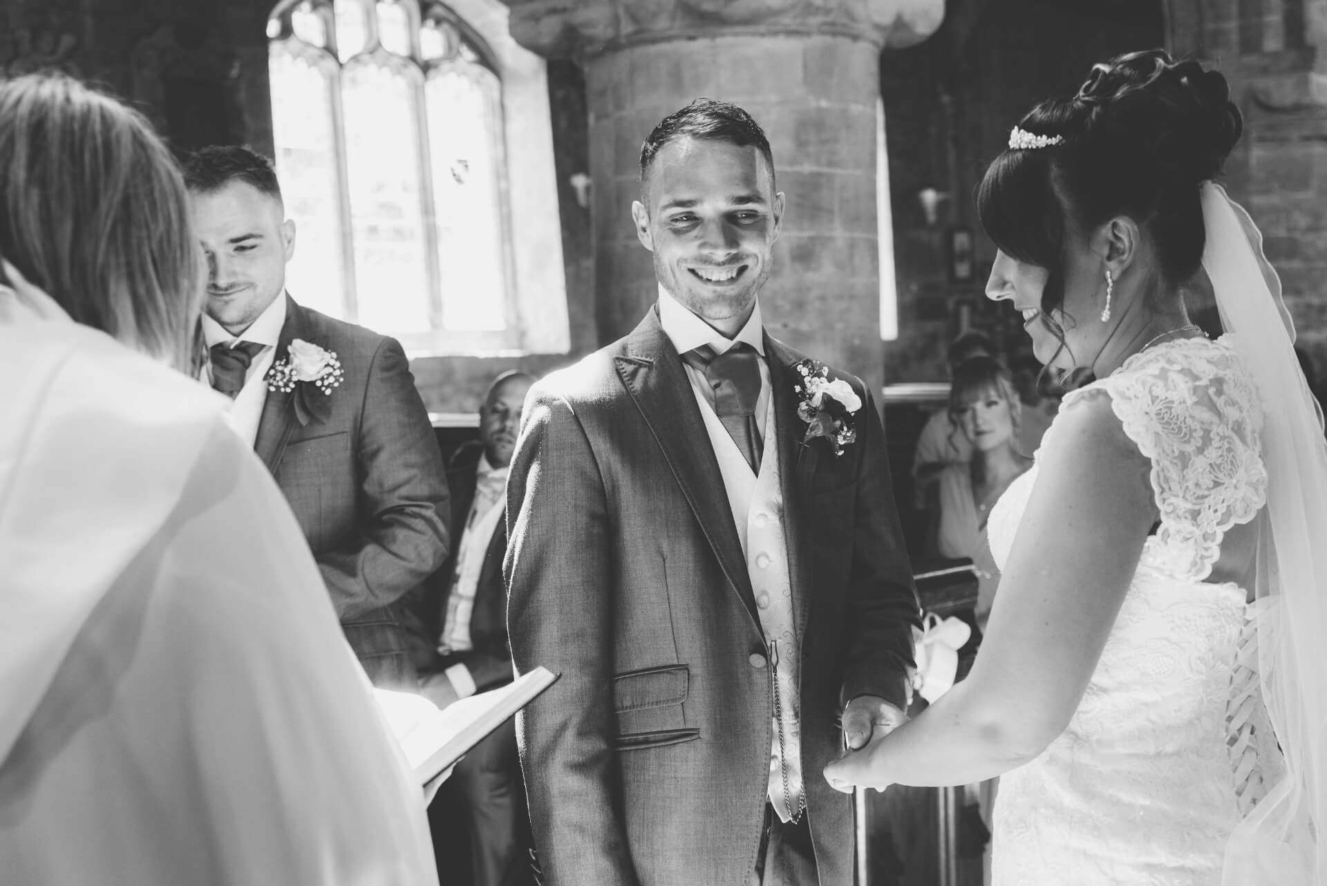 Whaplode Church Bride and Groom taking each others hands  - Lincolnshire wedding photographer Slice of Life Photography