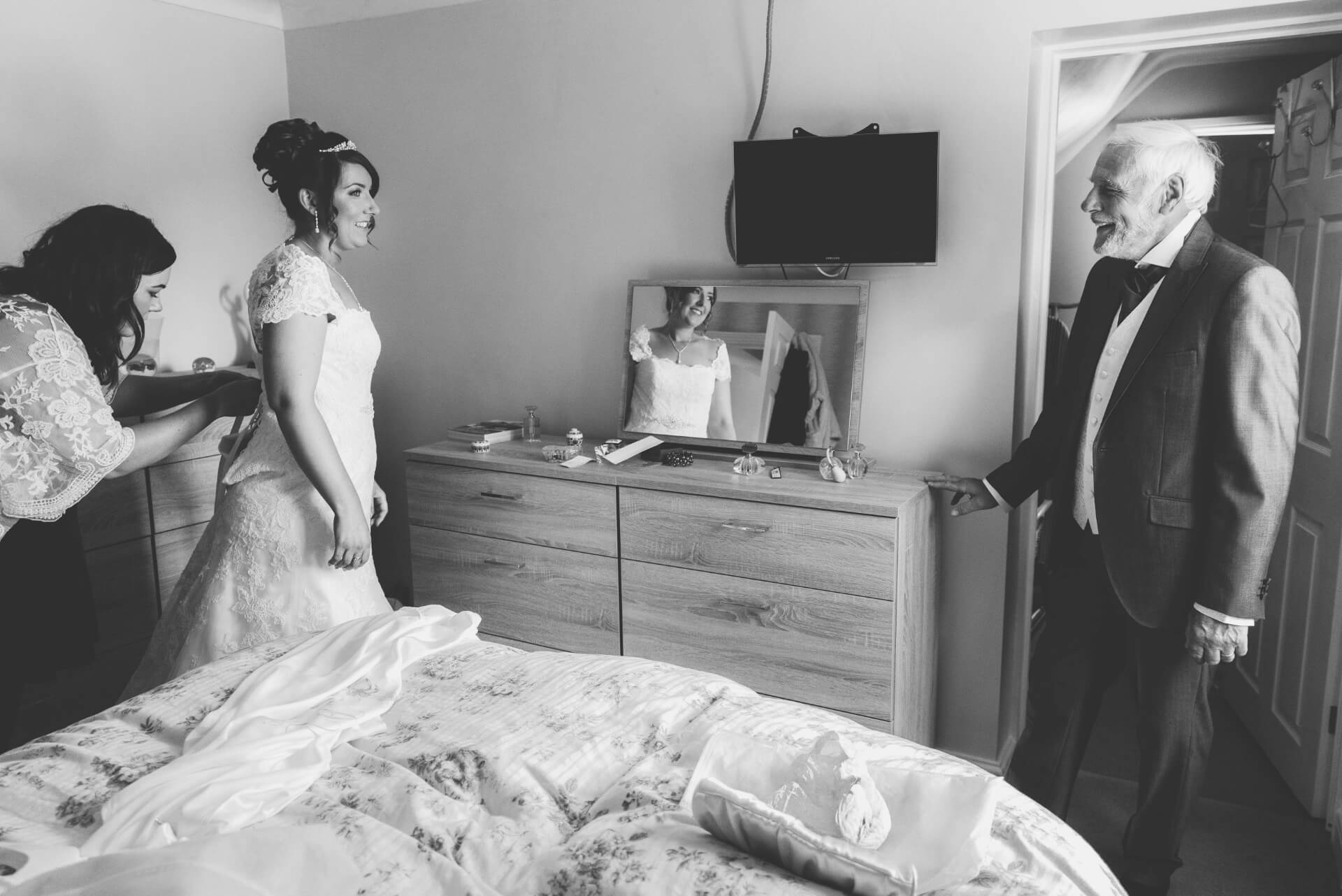 Bridal preparation - First glimpse of the bride by her father - Black and White Reportage wedding photos by Lincolnshire wedding photographer, Slice of Life Photography