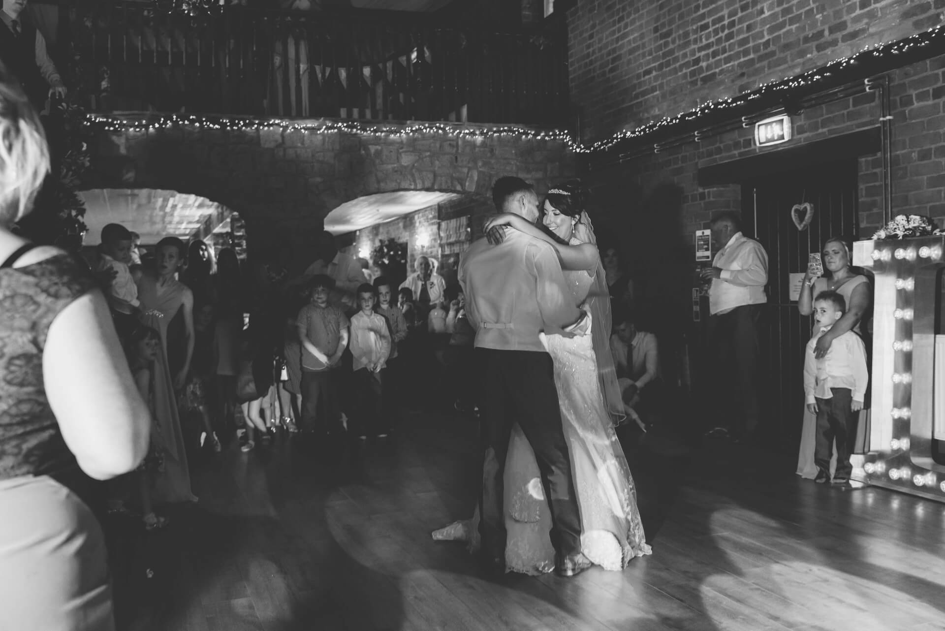 Mr and Mrs Burton's First dance at Whaplode Manor Wedding Reception - Black and white wedding photograph by Slice of Life Photography, Lincolnshire wedding photographer