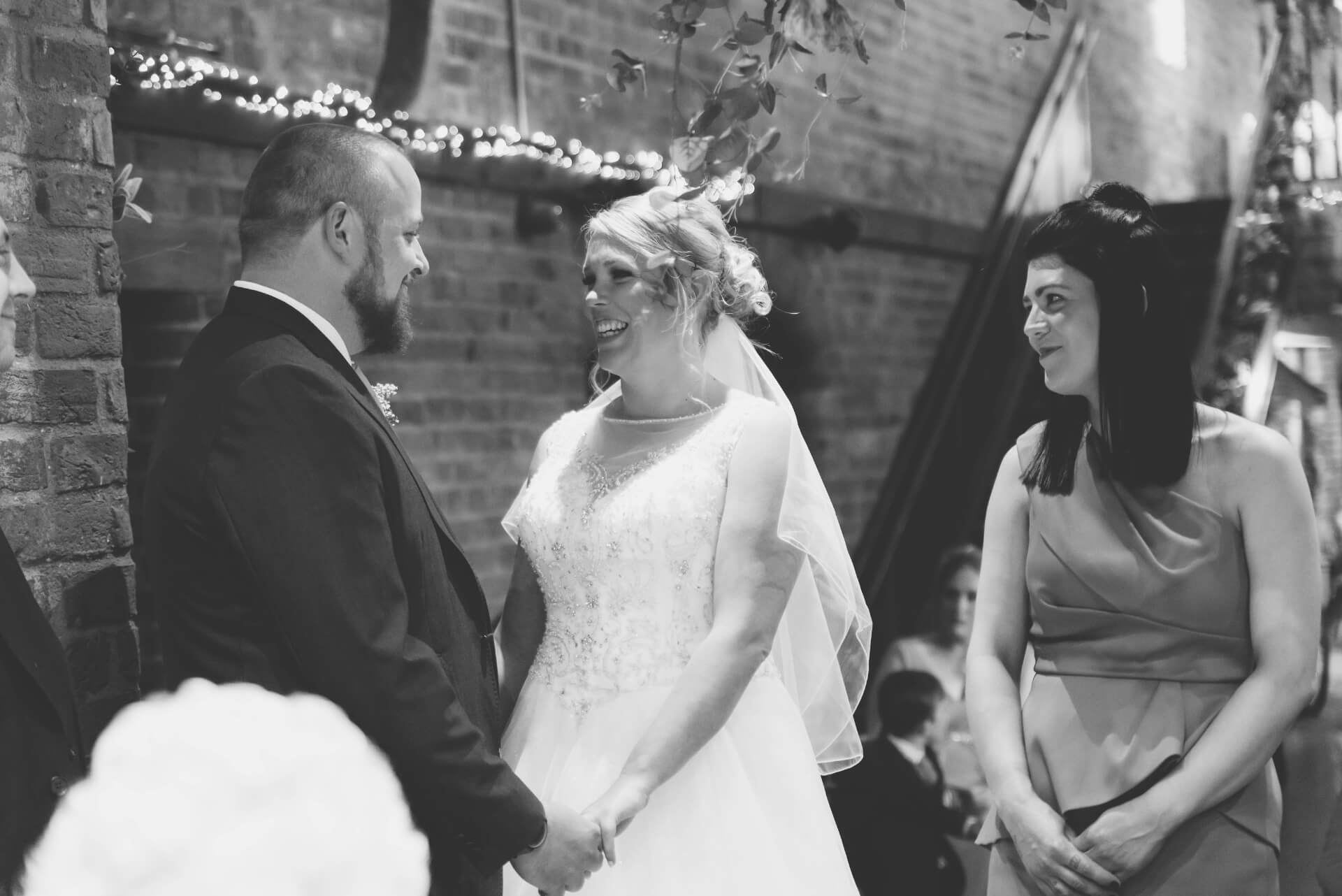 Bride and Groom saying vows during wedding ceremony - natural wedding photography at Whaplode Manor by Slice of Life
