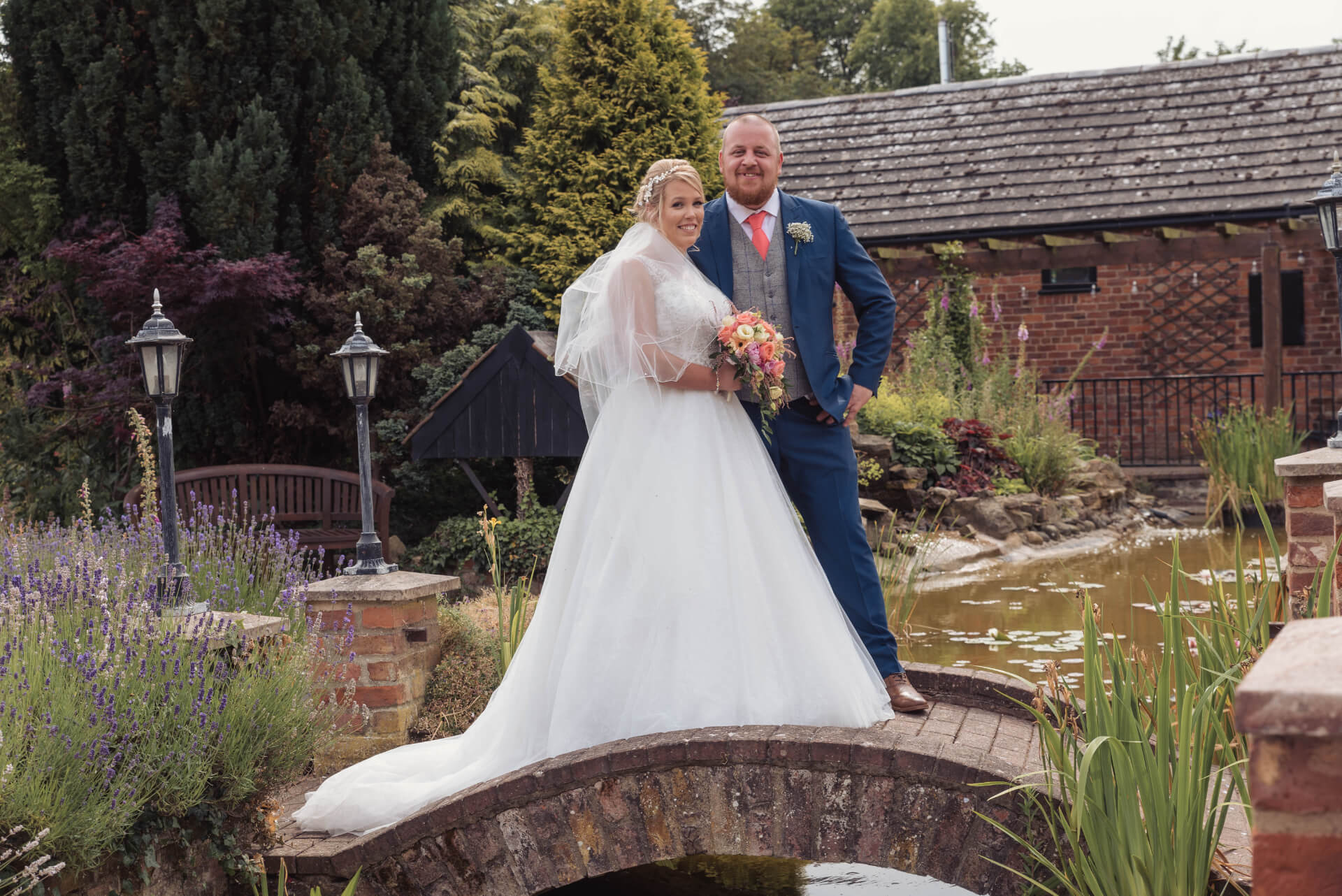 Bride and Groom portrait on bridge in Whaplode Manor Gardens - Wedding Photography By Slice of Life in Spalding