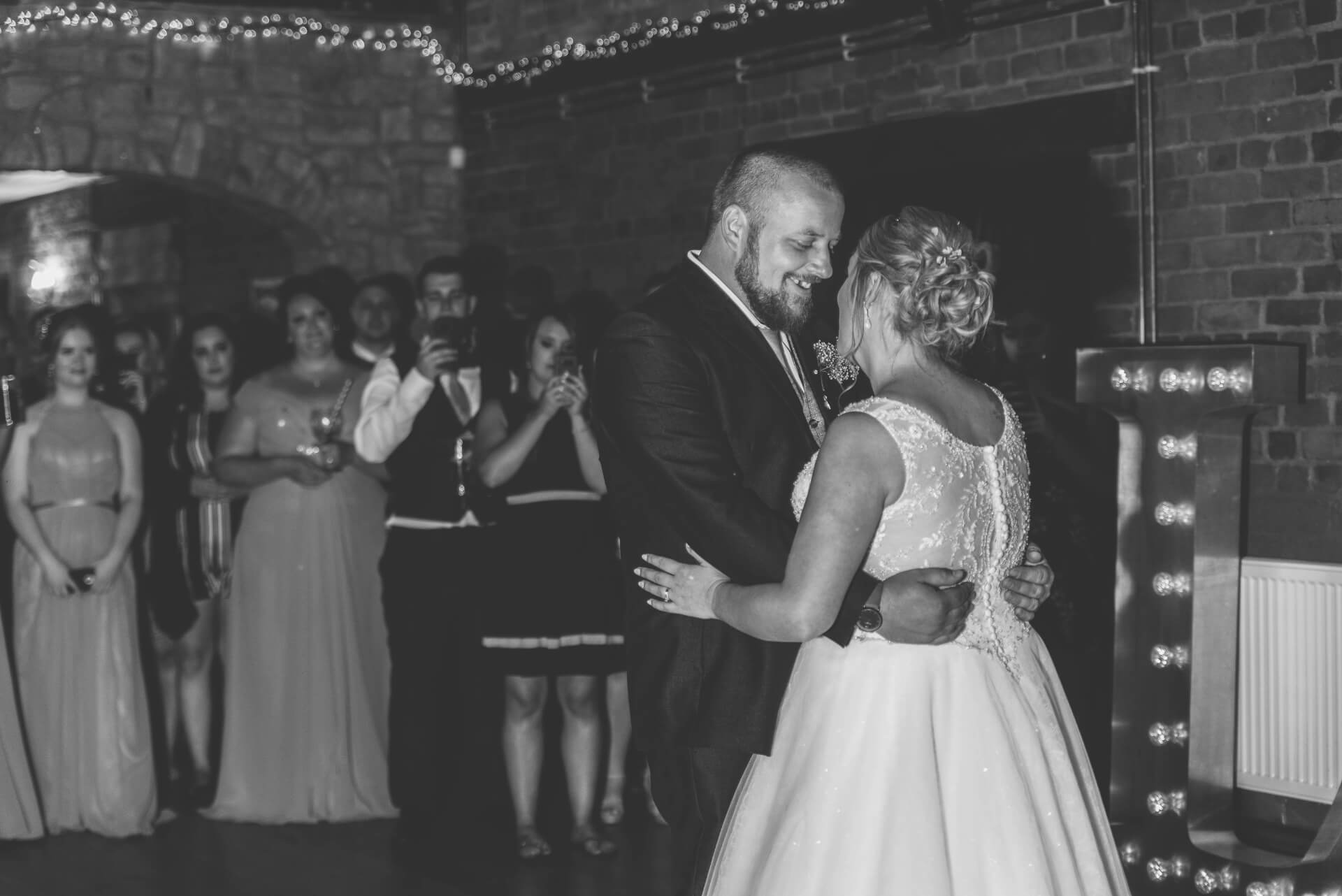 Bride and groom during first dance at Whaplode Manor by Slice of Life Photography