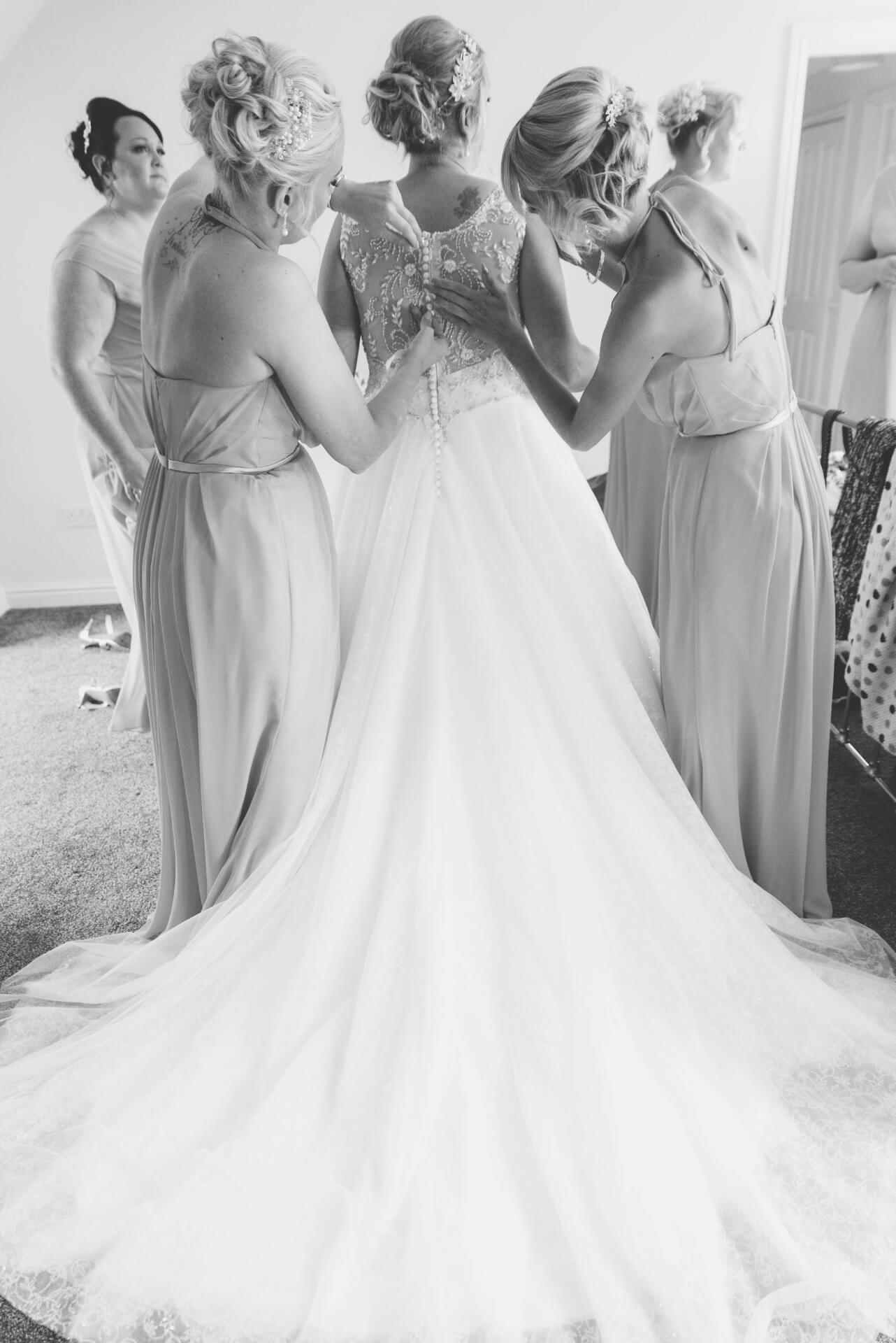 Bride putting on her Wedding Dress - natural wedding photography by Slice of Life Photography