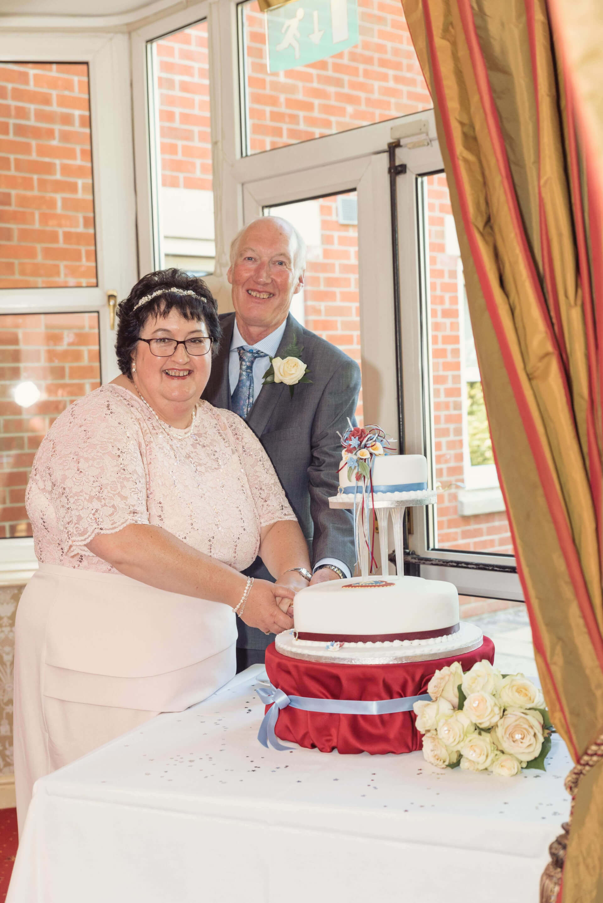Bride and Groom cake cutting - wedding photography - By Slice of Life Photography