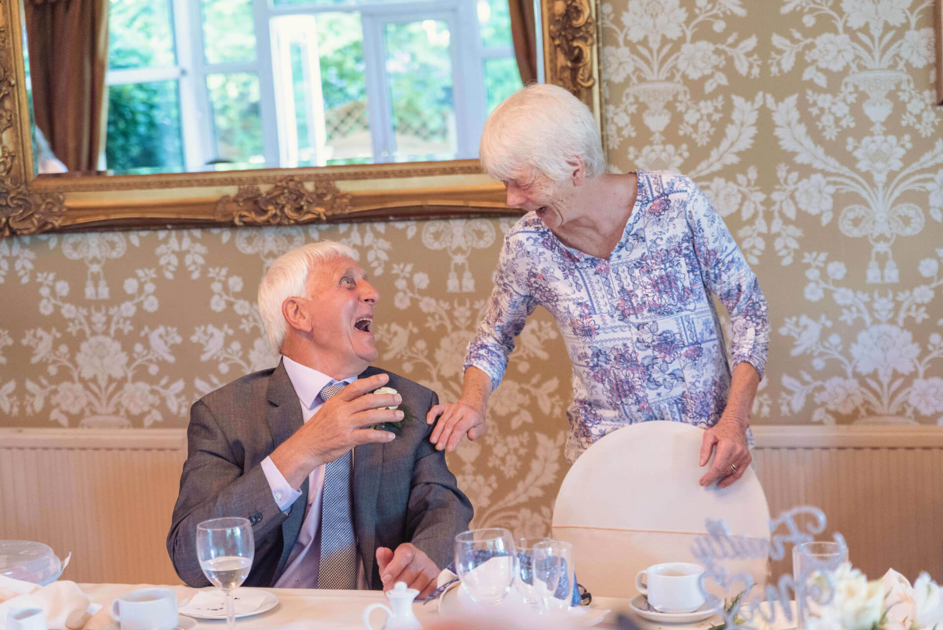Guests laughing during the wedding reception