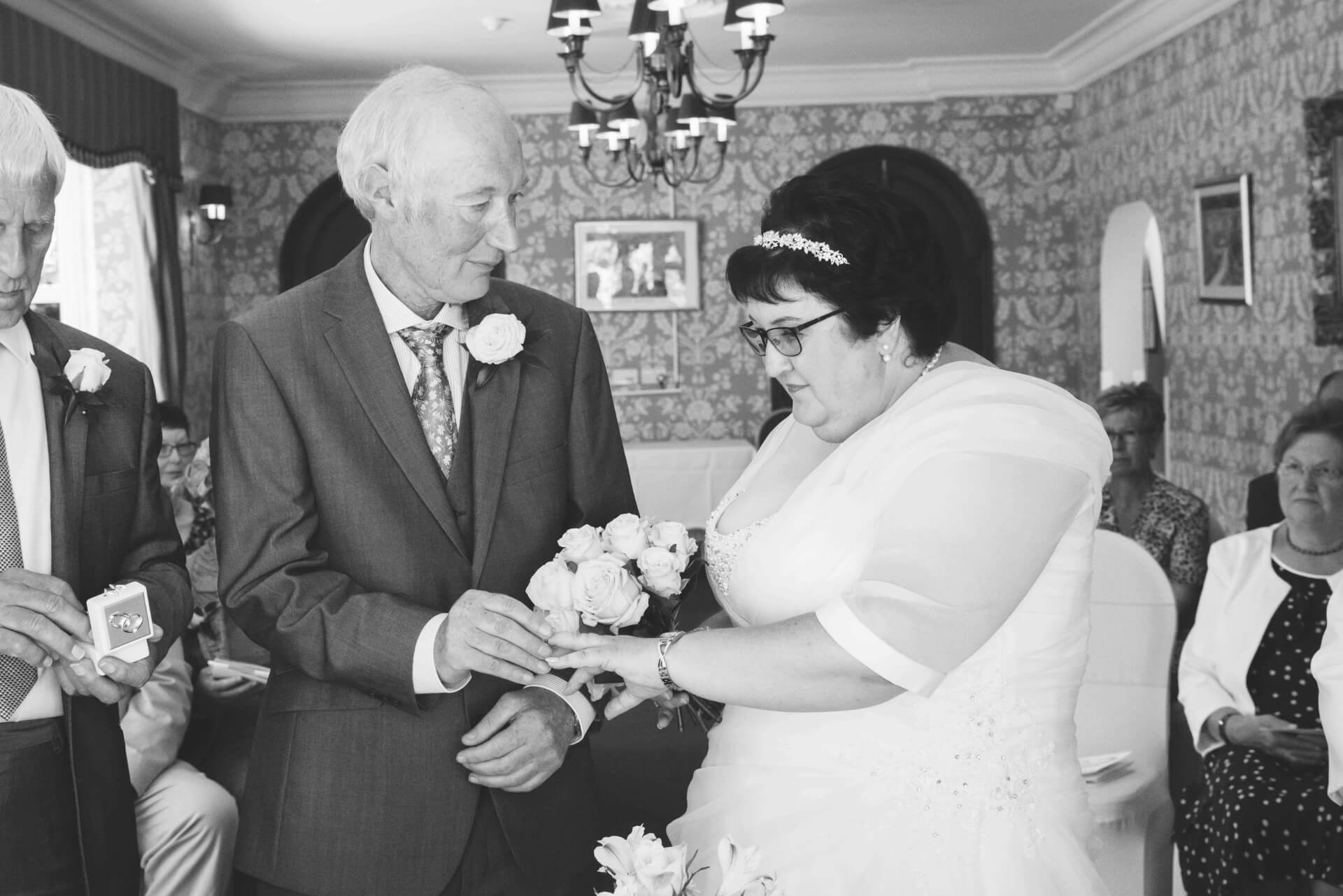 Exchanging of the rings during the wedding ceremony at Woodlands hotel, Spalding   Wedding photography at Woodlands Hotel Spalding by Slice of Life Photography