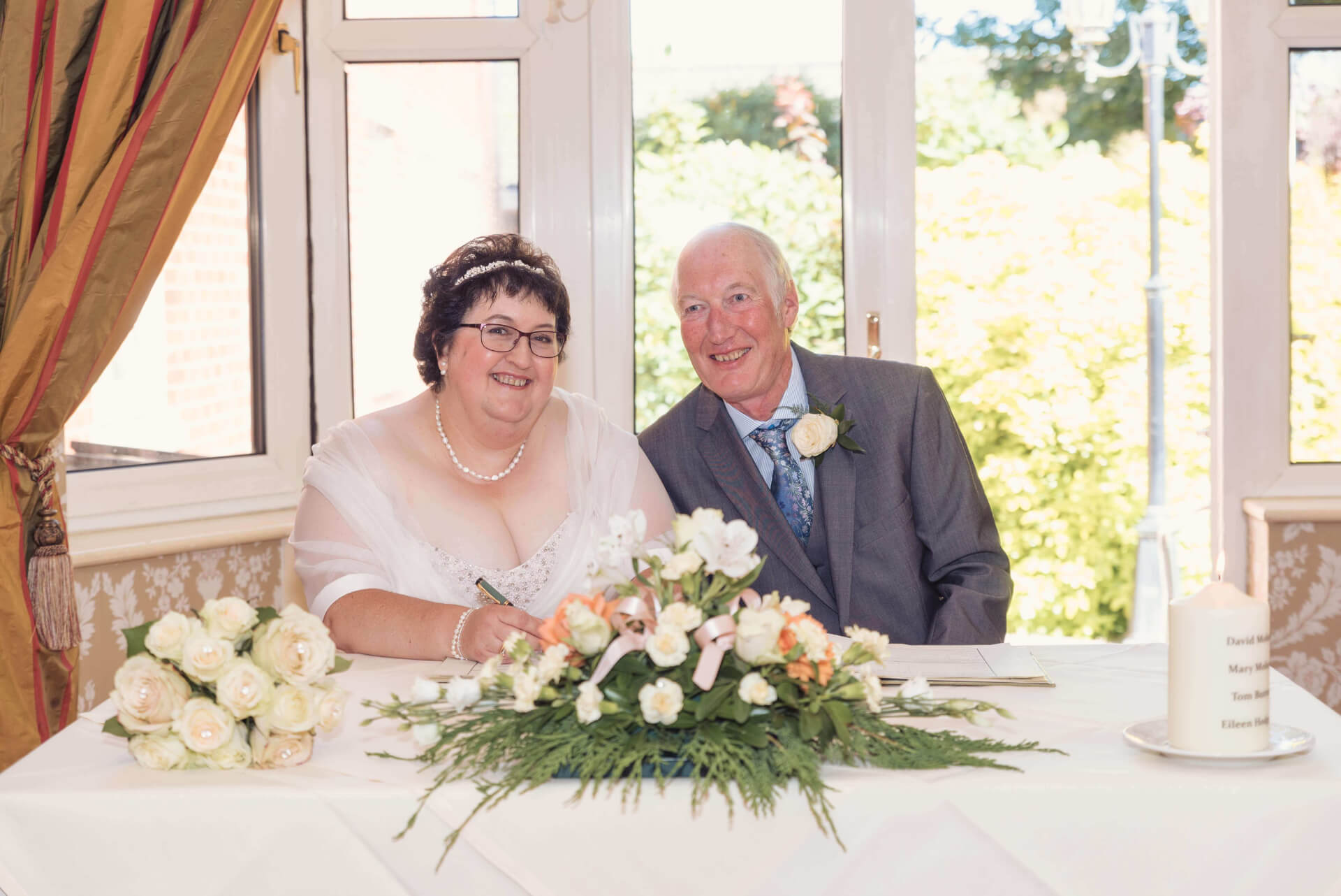 Signing of the register at Woodlands Hotel, Spalding wedding photography by Slice of Life Photography