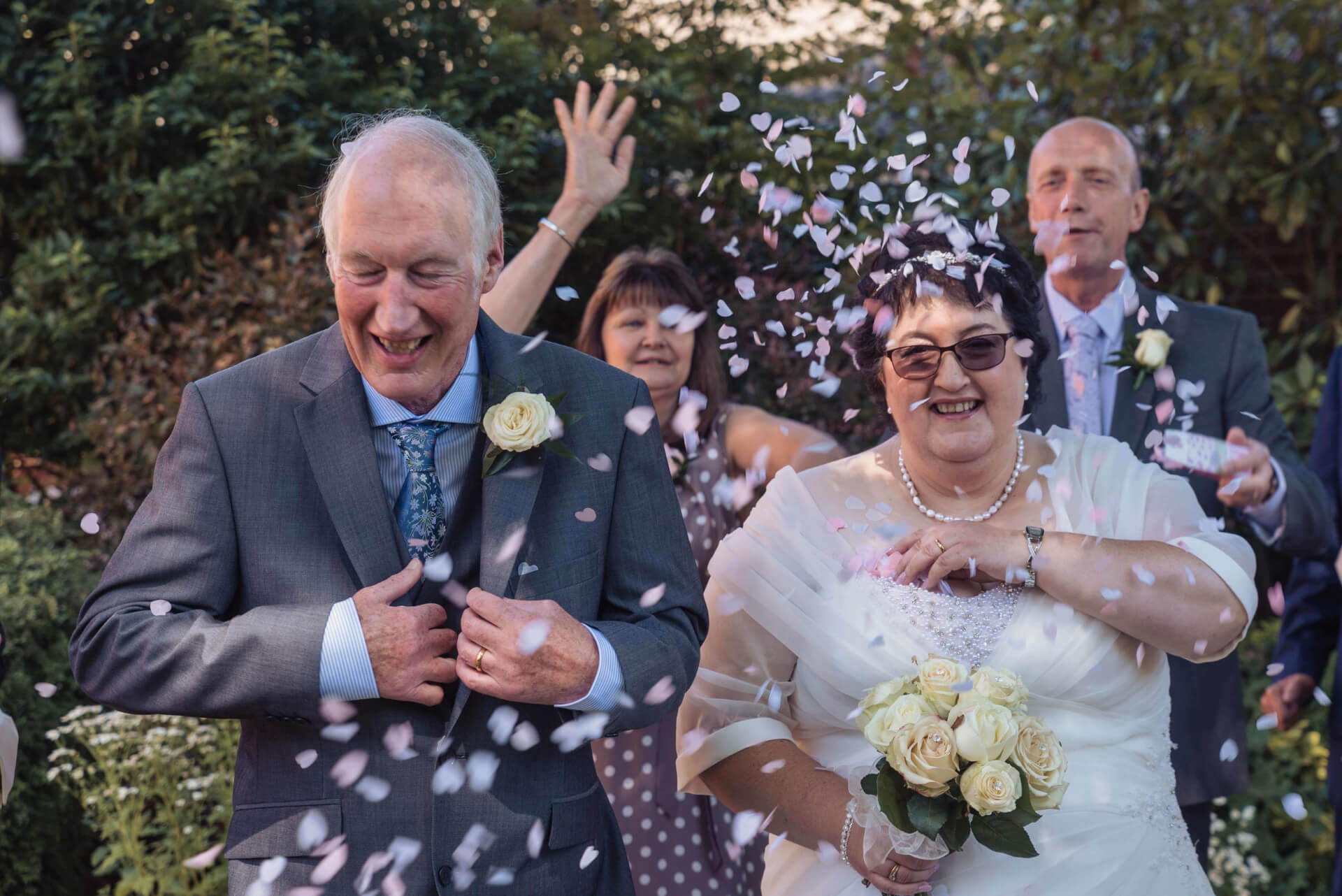 The Bride and Groom covered in confetti - Woodlands Hotel, Spalding - Wedding Photography by Slice of Life Photography