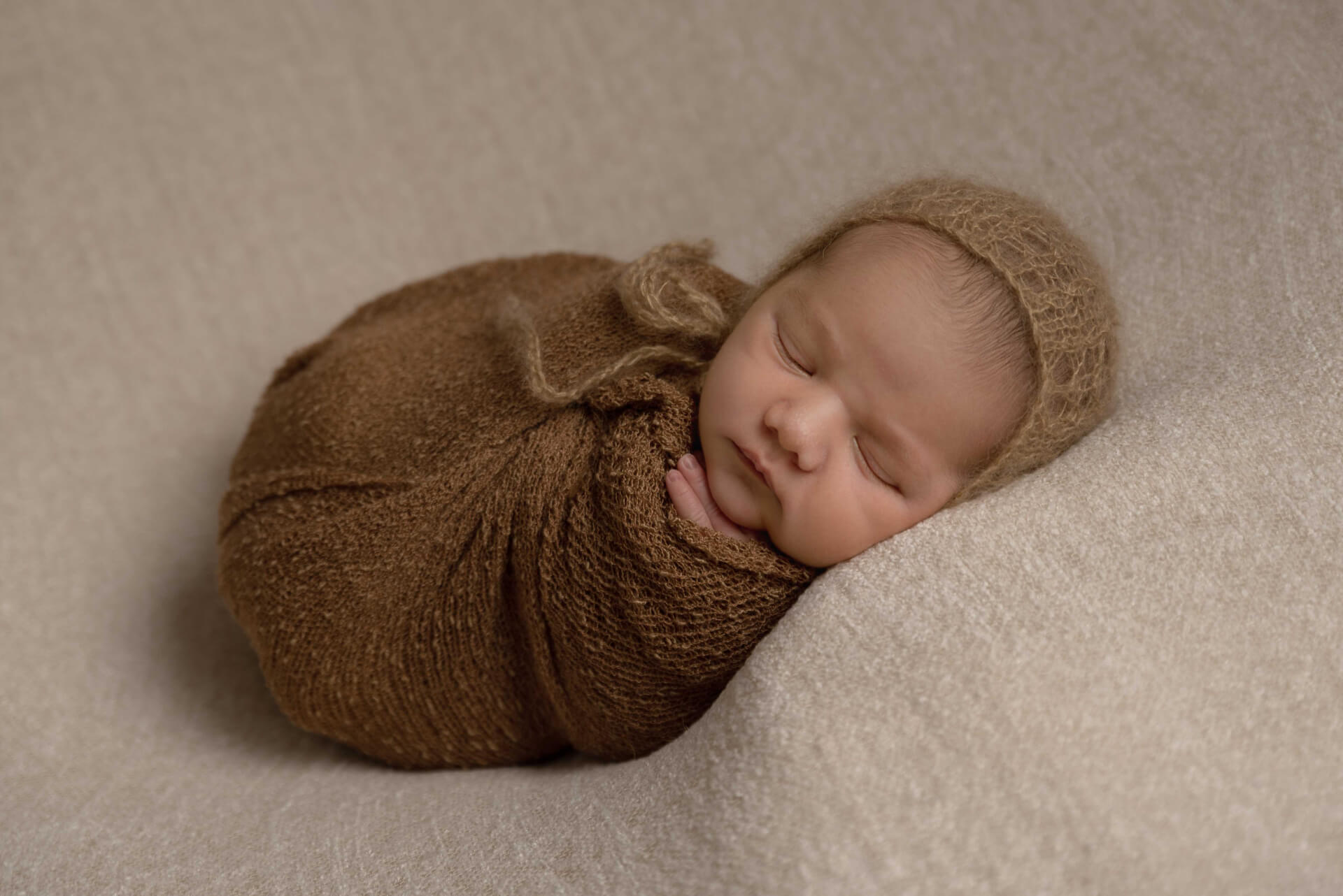 Wrapped newborn baby wearing a bonnet - Spalding newborn photographer Slice of Life